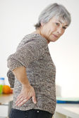 LOWER BACK PAIN IN ELDERLY PERS. — Stock Photo