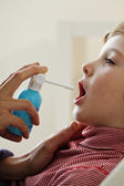 CHILD USING SPRAY IN MOUTH — Stock Photo