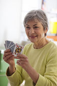 ELDERLY P. PLAYING A GAME — Stock Photo
