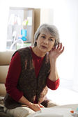 HEARING-IMPAIRED ELDERLY PERSON — Stock Photo