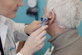 EAR NOSE &THROAT, ELDERLY PERSON — Stock Photo