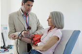 BLOOD PRESSURE, ELDERLY PERSON — Stock Photo