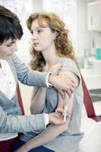 Doctor give an injection — Stock Photo