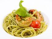 Spaghetti with sauce pesto and shrimps — Stock Photo