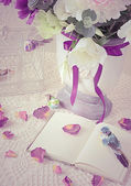 The book on a table with rose petals — Stock Photo