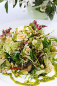 Salad with rucola and pine nuts — Stock Photo