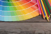 Color palette on the wooden background — Stock Photo