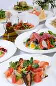 The buffet in the restaurant with different meals — Stock Photo