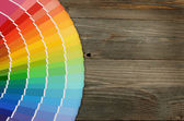 Color palette on the wooden background — 图库照片