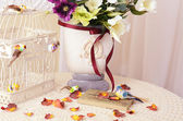 The book on a table with rose petals — Stockfoto