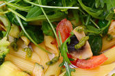 Pasta with vegetables and salad — Stock Photo