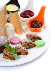 Plate of different desserts isolated — Stock Photo