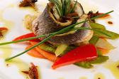 Sea bass fillet with spring vegetables — Photo