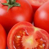 The red fresh tomatoes cut. Macro — Stock Photo
