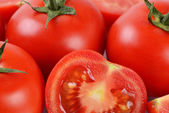 The red fresh tomatoes cut. Macro — Stock Photo