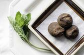Small plate of chocolate truffles. — Stock Photo