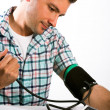 Man taking his blood pressure reading. — Stock Photo