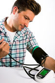 Man taking his blood pressure reading. — Foto Stock