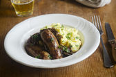 Sausages with mash — Stock Photo