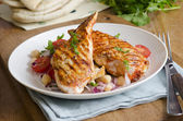 Harissa chicken with salad — Stock Photo