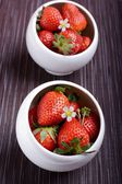 Strawberries in a two small white bowls — 图库照片