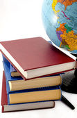 Books and the globe on a white background — Stock Photo