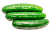 Three cucumbers the isolated — Stockfoto