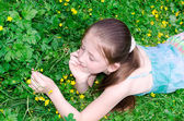The child has a rest on a glade with flowers — Stock Photo