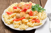 Macaroni with meatballs on a table — Stockfoto