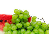 Grapes and water-melon on a white background — Stock Photo