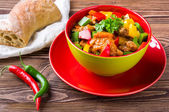 Delicious goulash on wooden table — Stock Photo