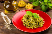 Tagliatelle with pesto — Stock Photo