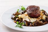 Steak with mushroom sauce — Stock Photo