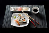 Sushi on white plate — Stock Photo