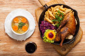 Roasted duck and potato wedges — Stock Photo