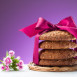 Oatmeal cookies and blooming flower — Stock Photo #47393821