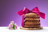 Oatmeal cookies and blooming flower — Stock Photo