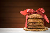 Oatmeal cookies on wooden table — Stock Photo