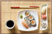 Sushi on white plate — Stock Photo