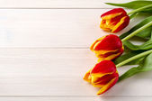 Tulips wooden table — Stock Photo