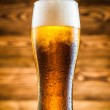 Glass of cold beer on wooden table — Stock Photo #48050469