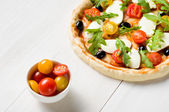 Preparing a pizza on a wooden table — Stock Photo