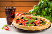 Pizza and coke on wooden table — Stock Photo