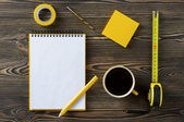 Notebook, coffee and technical tools on the table — Stock Photo