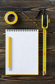 Notebook and technical tools on the table — Stock Photo