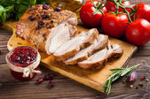 Roasted pork loin with cranberry and rosemary — Stock Photo