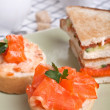 Salmon sandwiches with cup of coffee — Stock Photo