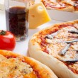 Stock Photo: Three different kinds of pizzand glass of cola