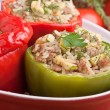 Stuffed peppers in a red dish — Stock Photo