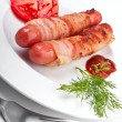 Sausages wrapped in bacon — Stock Photo #41982231